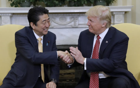 Trump and Abe Meet, Golf and Shake Hands…For a Long Time