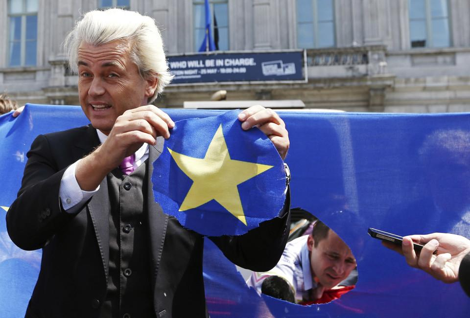 Dutch far-right Freedom Party (PVV) leader Geert Wilders holds a star he had just cut from the European Union flag during a demonstration in front of the EU Parliament in Brussels May 20, 2014. It was meant to be the campaign launch of a new Eurosceptic alliance, but the planned April 16 meeting starring France's Marine Le Pen and Dutchman Geert Wilders in Strasbourg, home of the European Parliament, never took place.