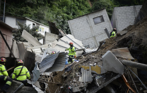Rescuers search for victims after a landslide at Cambray village, in Santa Catarina Pinula municipality, Guatemala on October 2, 2015. The landslide destroyed 60 houses killing at least one person and injurering 25. An unquantified missing people were reported.  AFP PHOTO / Johan ORDONEZ        (Photo credit should read JOHAN ORDONEZ/AFP/Getty Images)