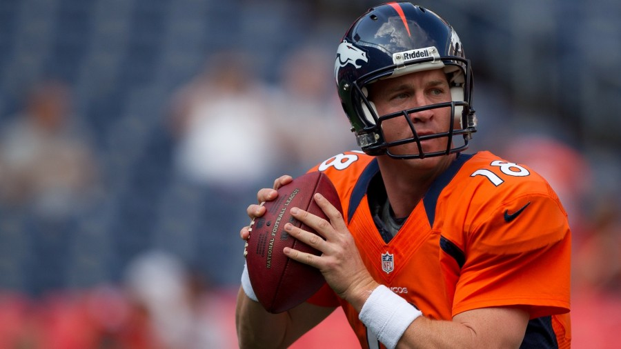 DENVER, CO - AUGUST 18:  Quarterback Peyton Manning #18 of the Denver Broncos warms up before a game against the Seattle Seahawks at Sports Authority Field Field at Mile High on August 18, 2012 in Denver, Colorado. (Photo by Justin Edmonds/Getty Images) *** Local Caption *** Peyton Manning