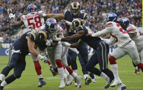 Landon Collins, pictured in the middle number 21, had a huge game against the Rams with two interceptions and a touchdown.