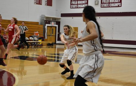 Amanda Laguardia, senior, passes the ball to Taylor Rodriguez.