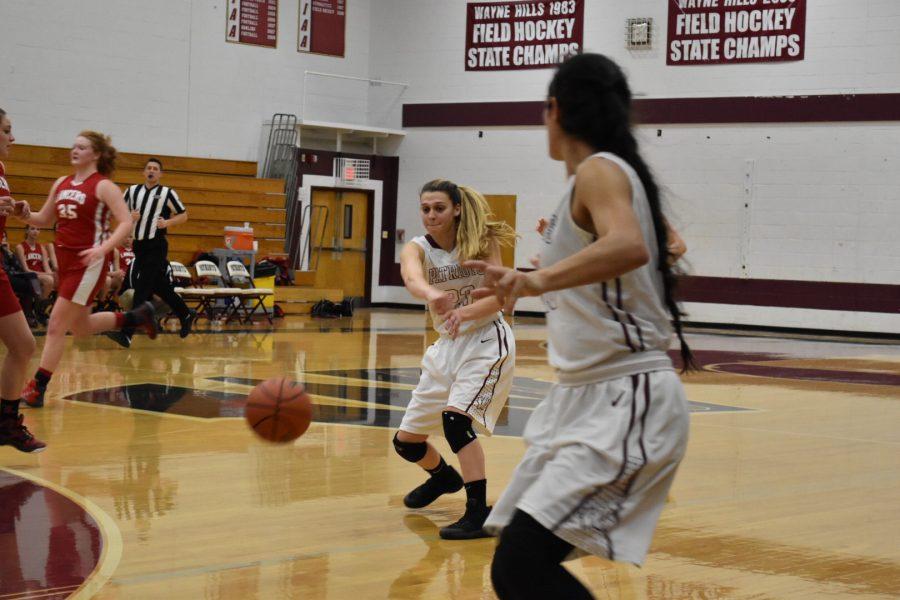 Amanda Laguardia, senior, passes the ball to Taylor Rodriguez.