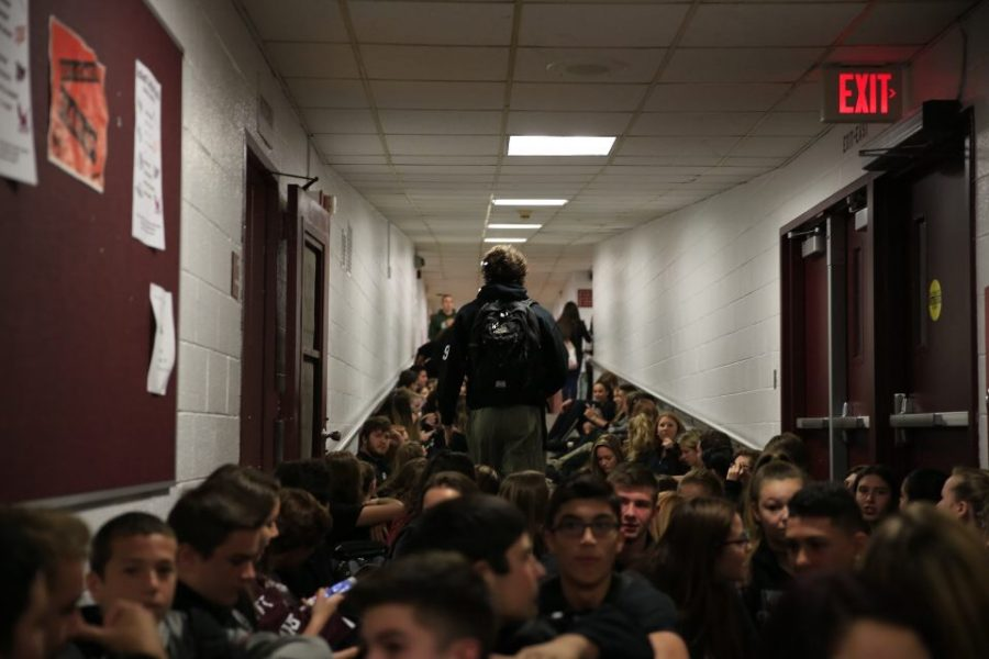 Hunter Hayek walks through the crowd of students protesting the post season disqualification.
