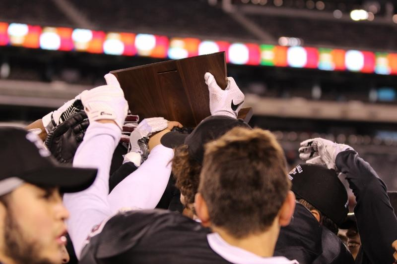 The Patriots were able to raise their prize after a hard fought, come from behind win against their crosstown rivals, the Wayne Valley Indians at MetLife Stadium.
