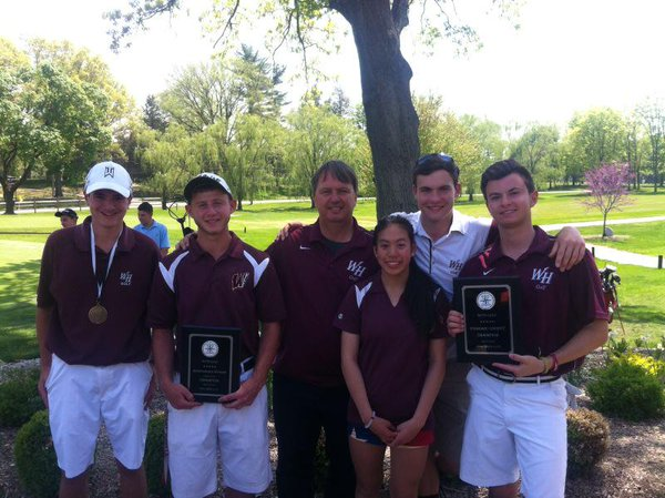 Coach DuBois is pictured with his team after winning the Big North Conference golf tournament.
