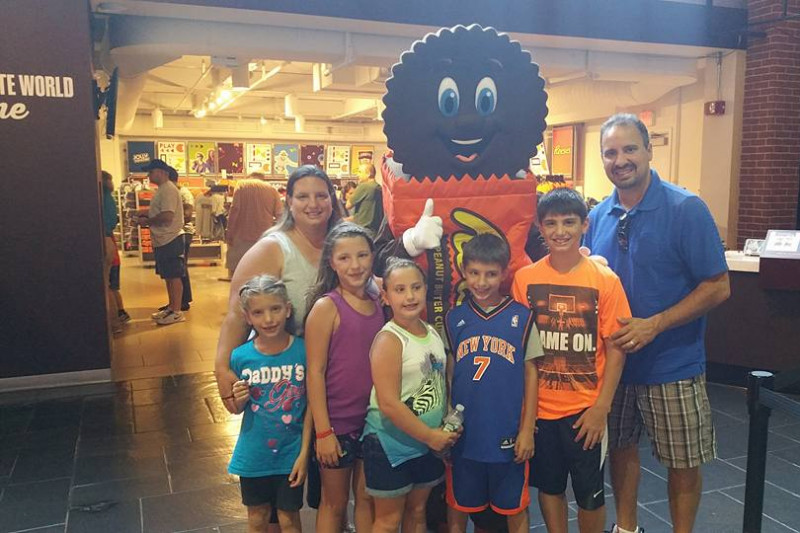 Matthew Polifonte (middle in Knicks jersey) pictured with his family.