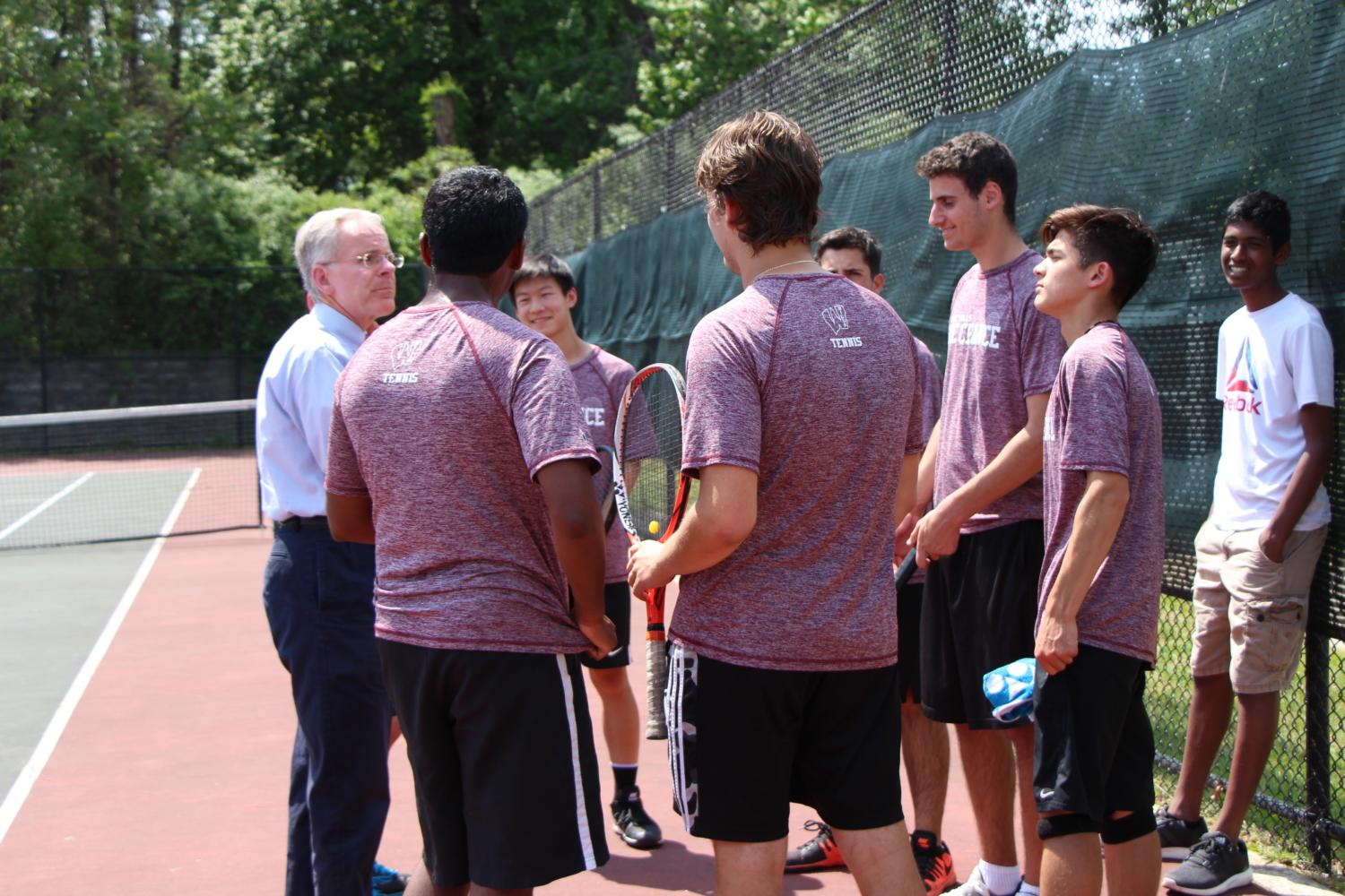 The Boys tennis team went undefeated during the regular season with a 19-0 record.  Coach Bruce Keogh speaks to his team members.