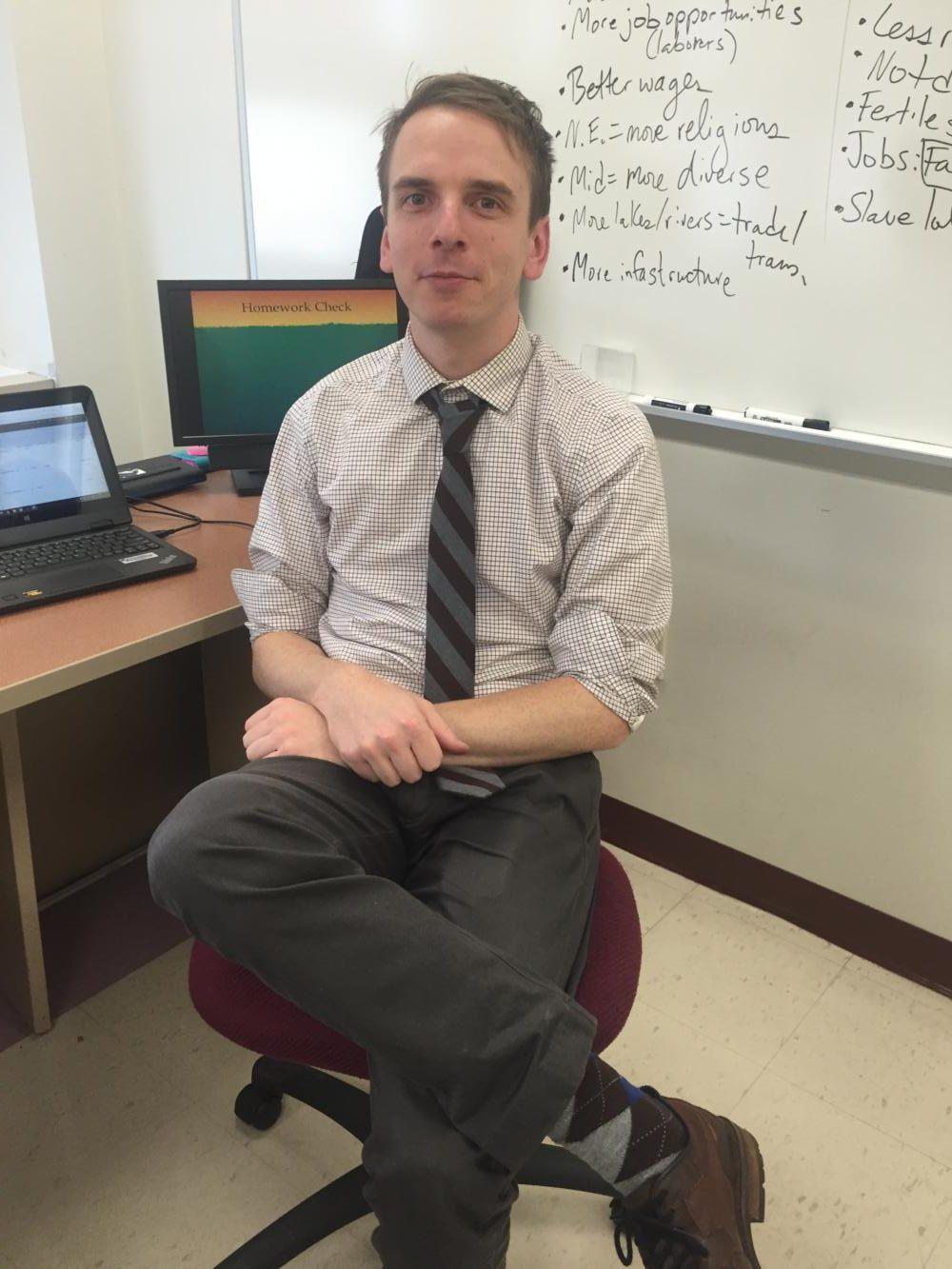 New history teacher, John Terry, introduces himself to Wayne Hills.
