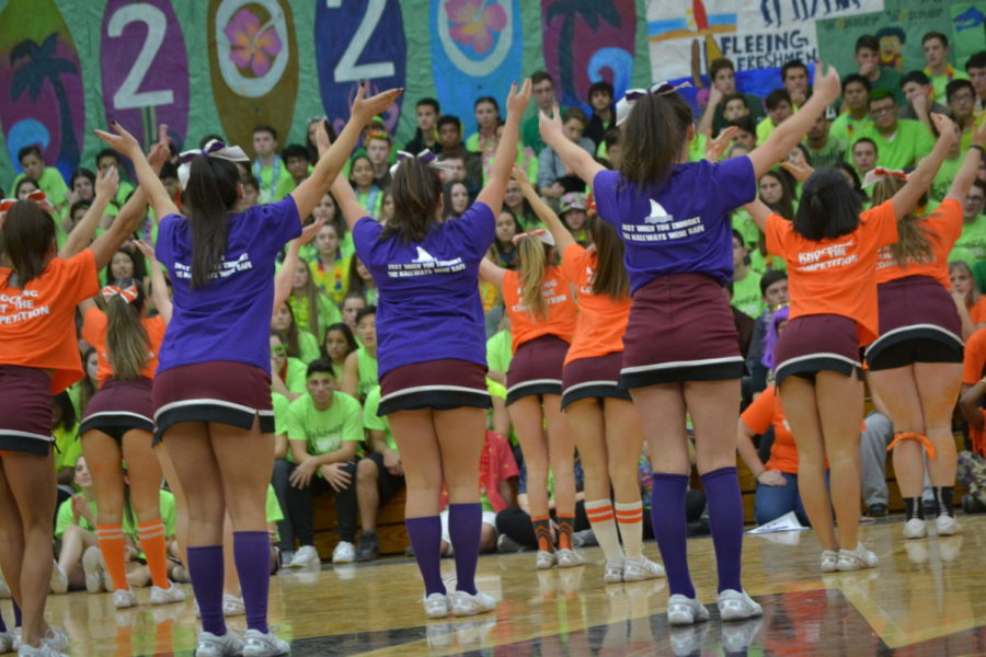 Varsity cheerleaders performing their routine in front of the Spirit Rally crowds.