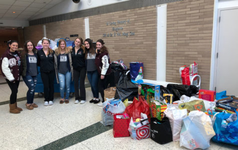 Girls from WHHS and WVHS collecting toys.