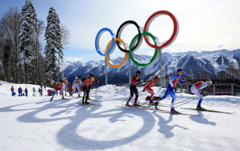 SOCHI, RUSSIA - FEBRUARY 19:  (R-L) Emil Joensson of Sweden, Iivo Niskanen of Finland, Maciej Kreczmer of Poland and Simeon Hamilton of the United States lead a group past the Olympic rings as they compete in the Men's Team Sprint Classic Semifinals during day 12 of the 2014 Sochi Winter Olympics at Laura Cross-country Ski & Biathlon Center on February 19, 2014 in Sochi, Russia.  (Photo by Richard Heathcote/Getty Images)