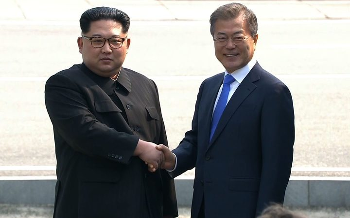 Northern+Leader+Kim+Jong+Un+and+President++Moon+Jae-in+of+South+Korea+shake+hands+along+the+military+demarcation+line+at+Panmunjom.+Photo%3A+AFP+%2F+KOREAN+BROADCASTING+SYSTEM
