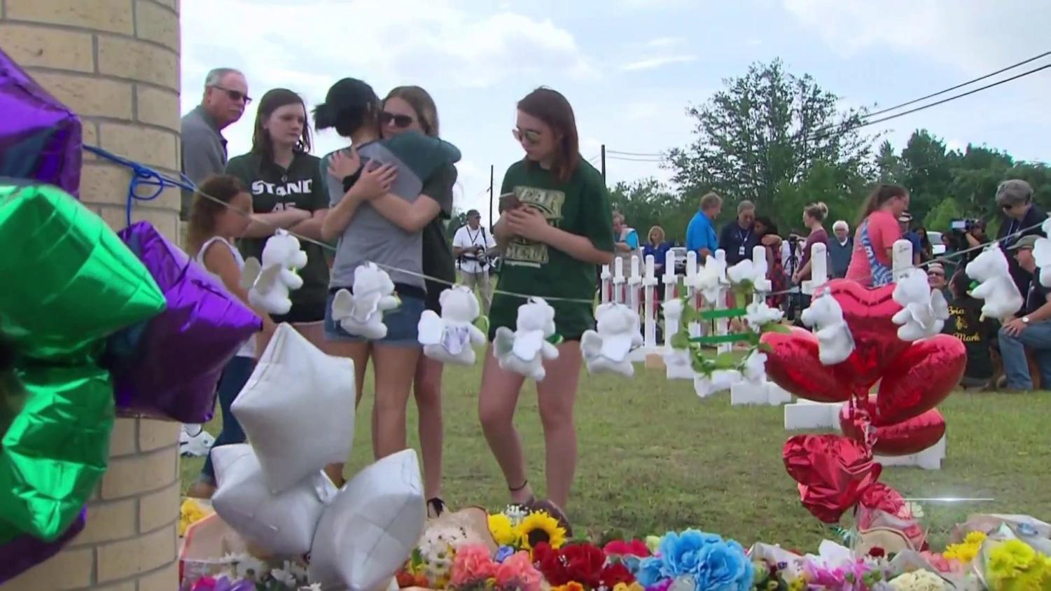 Students+hugging+and+coping+at+the+memorial+service.