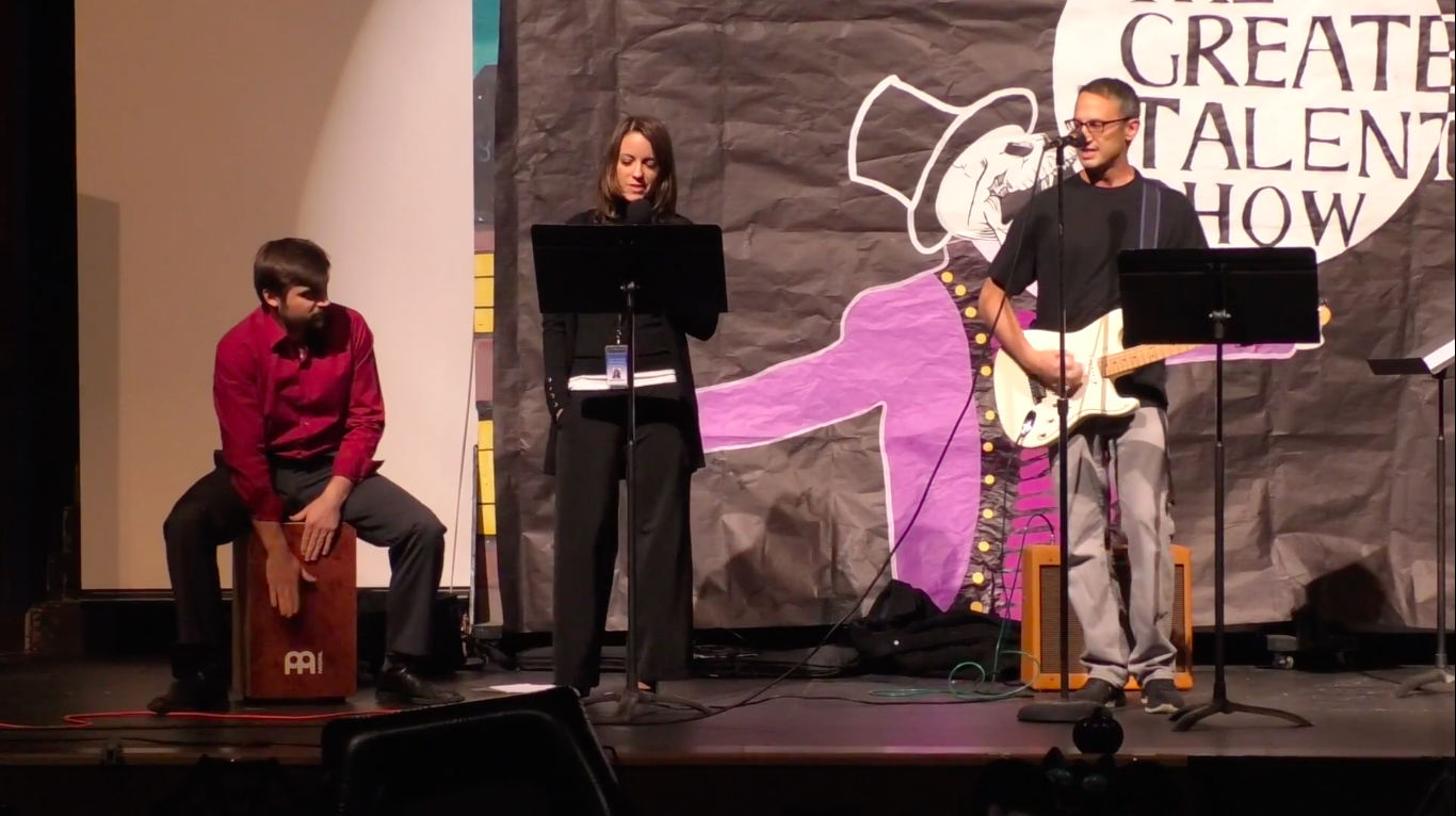 Assistant principal Kristy Stofey and teachers Neil Ascione and Andrew Poalillo perform Tom Petty's