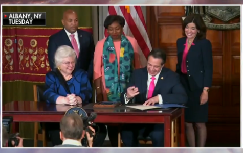 New York Governor Andrew Cuomo signs a controversial late-term abortion bill.