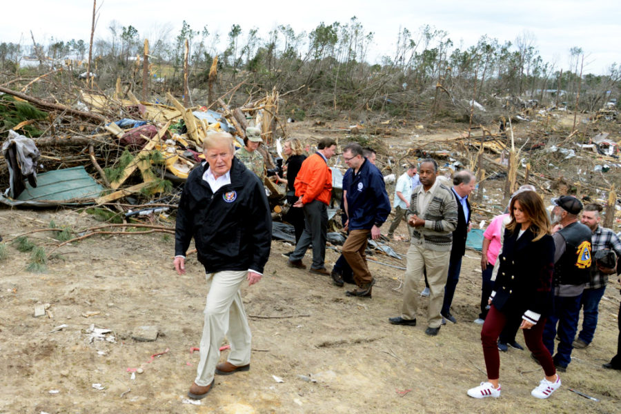 President+Trump+and+the+First+Lady+survey+damages+from+the+tornado+disaster.+