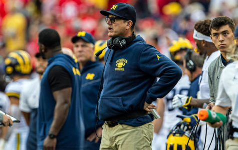 Jim Harbaugh looks on, baffled, as his team his trounced by Wisconsin.