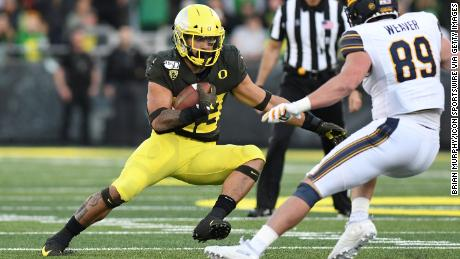 Oregon Ducks Player Tackles Rowdy Fan on the Field