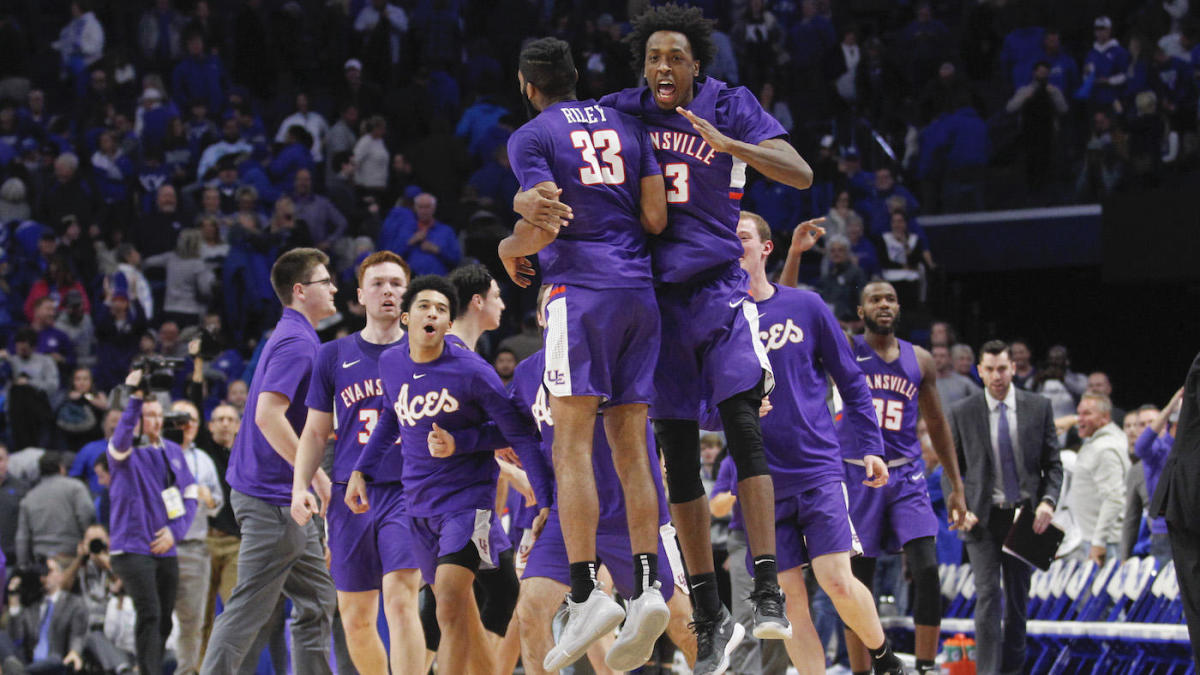 K.J. Riley celebrates with his teammates after Evansville upsets #1 Kentucky at Rupp Arena.