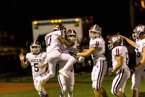 Wayne Hills players celebrate with quarterback Michael Casasanta after he ran for a long touchdown..