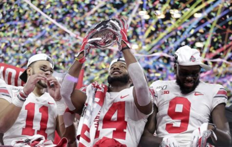Ohio State players celebrate after defeating Wisconsin 34-21 in the Big Ten Championship Game.