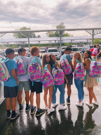 Seniors showing their stylish backpacks on the first day of school