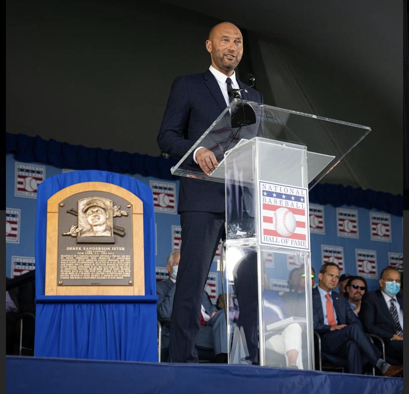 Derek Jeter stands at a podium