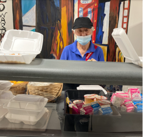 Man serves out school lunch