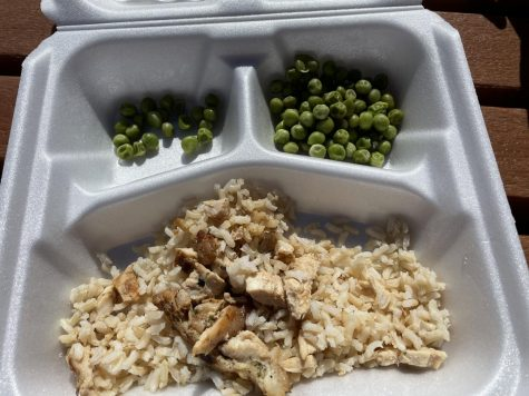 School lunch that is rice, chicken, and peas