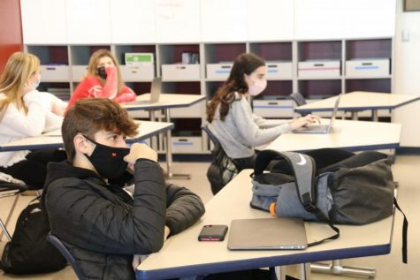 Picture of Students Sitting in A Classroom with Masks on